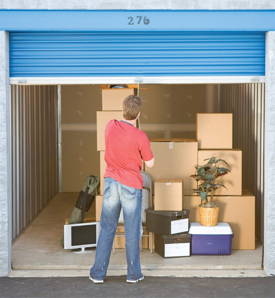 Picture Showing Man Closing Door Of Outside Accessible Self Storage Unit