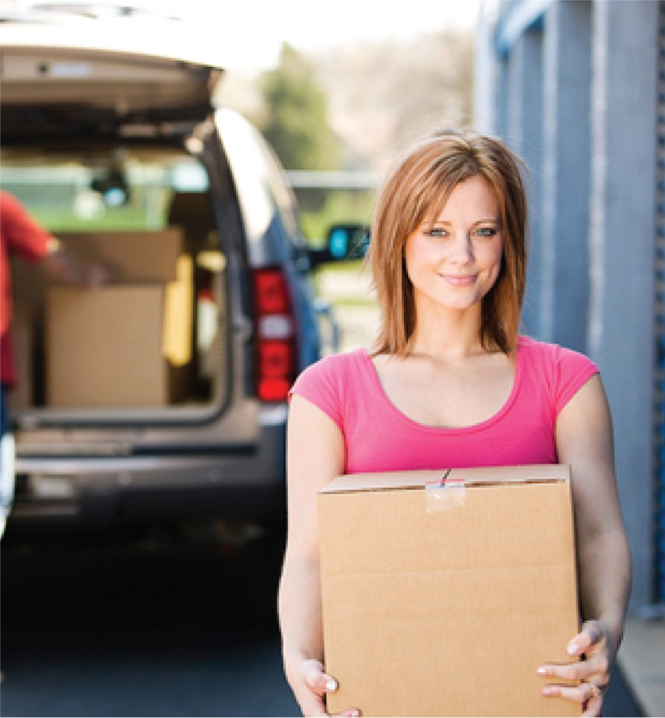 Picture of woman moving boxes into a self storage unit